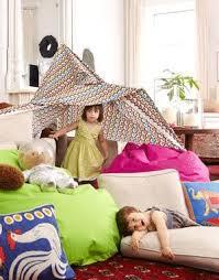 Children playing with a pillow fort