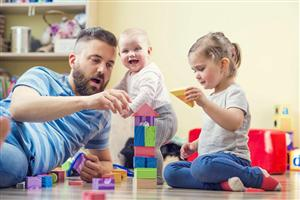 Father playing with children - the importance of play