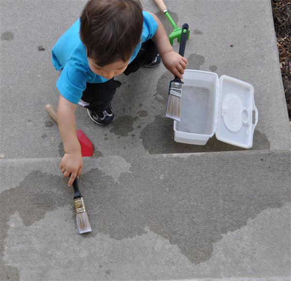 Child painting with water