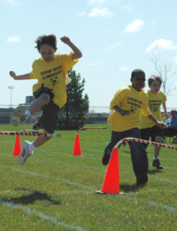 Students participate in a track and field event.