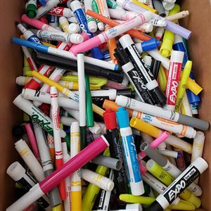 assorted markers in a box