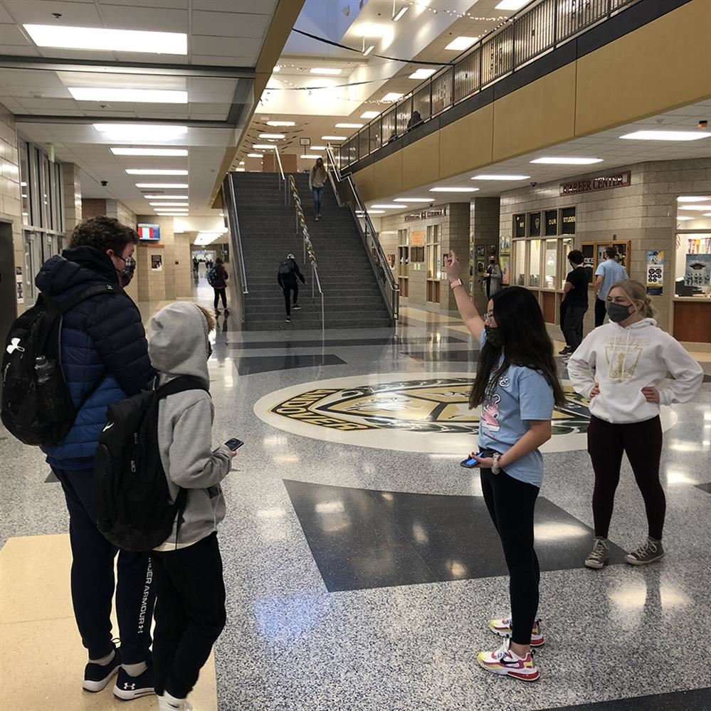 Senior students help ninth-graders find their classes