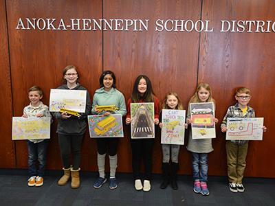Anoka-Hennepin's poster contest winners were recognized at a transportation department meeting on March 4
