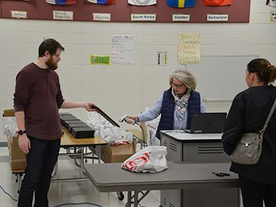 Anoka-Hennepin staff distribute technology at Andover Elementary School on April 3
