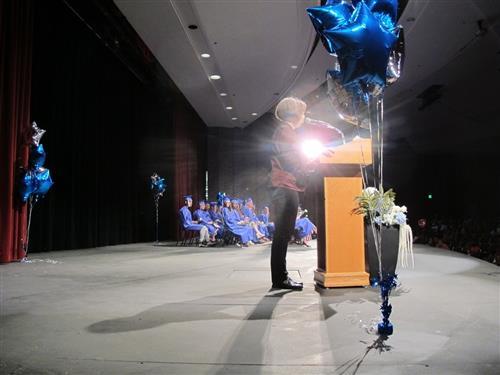 Graduates wait on stage at ceremony
