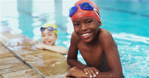 Children in pool smiling