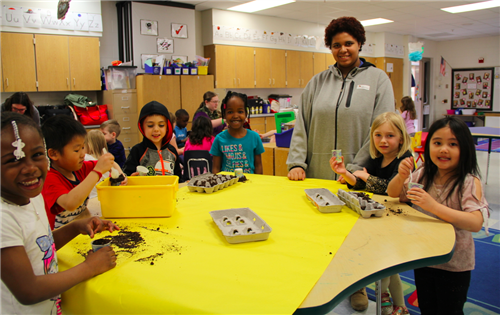 CRHS students partner with kindergarteners to plant seeds in celebration of Earth Day