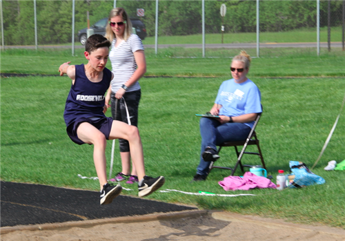 Boy doing long jump