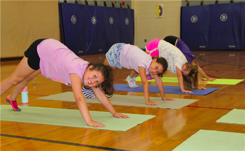 Students at Oxbow Creek try yoga at Adventures Plus.