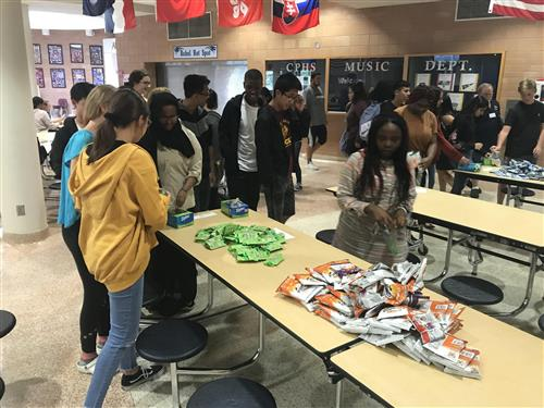 Students at CPHS assmeble snack kits for elementary school students in need