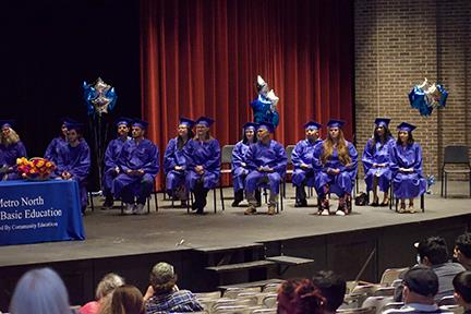 graduates sitting in chairs