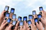 picture of lots of texting phones