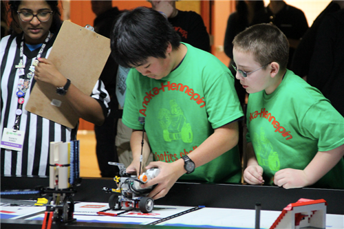 Green team sets robot up to compete in performance