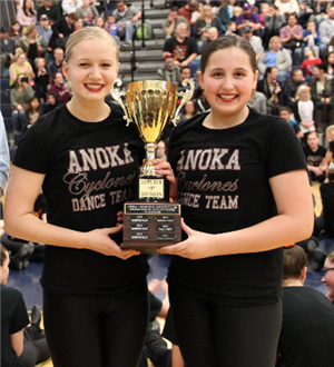 Two members of the Anoka MS dance team accept the trophy